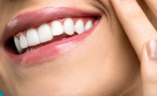 women smiles after gum disease treatment