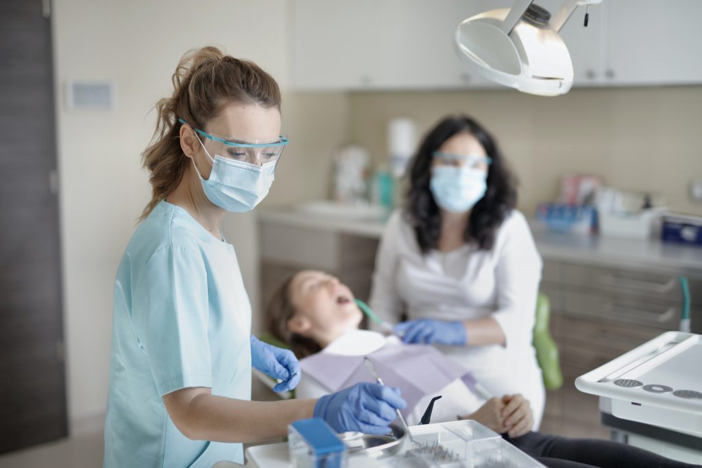 Dentists prepping for gum surgery