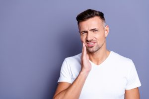 man with periodontal pain