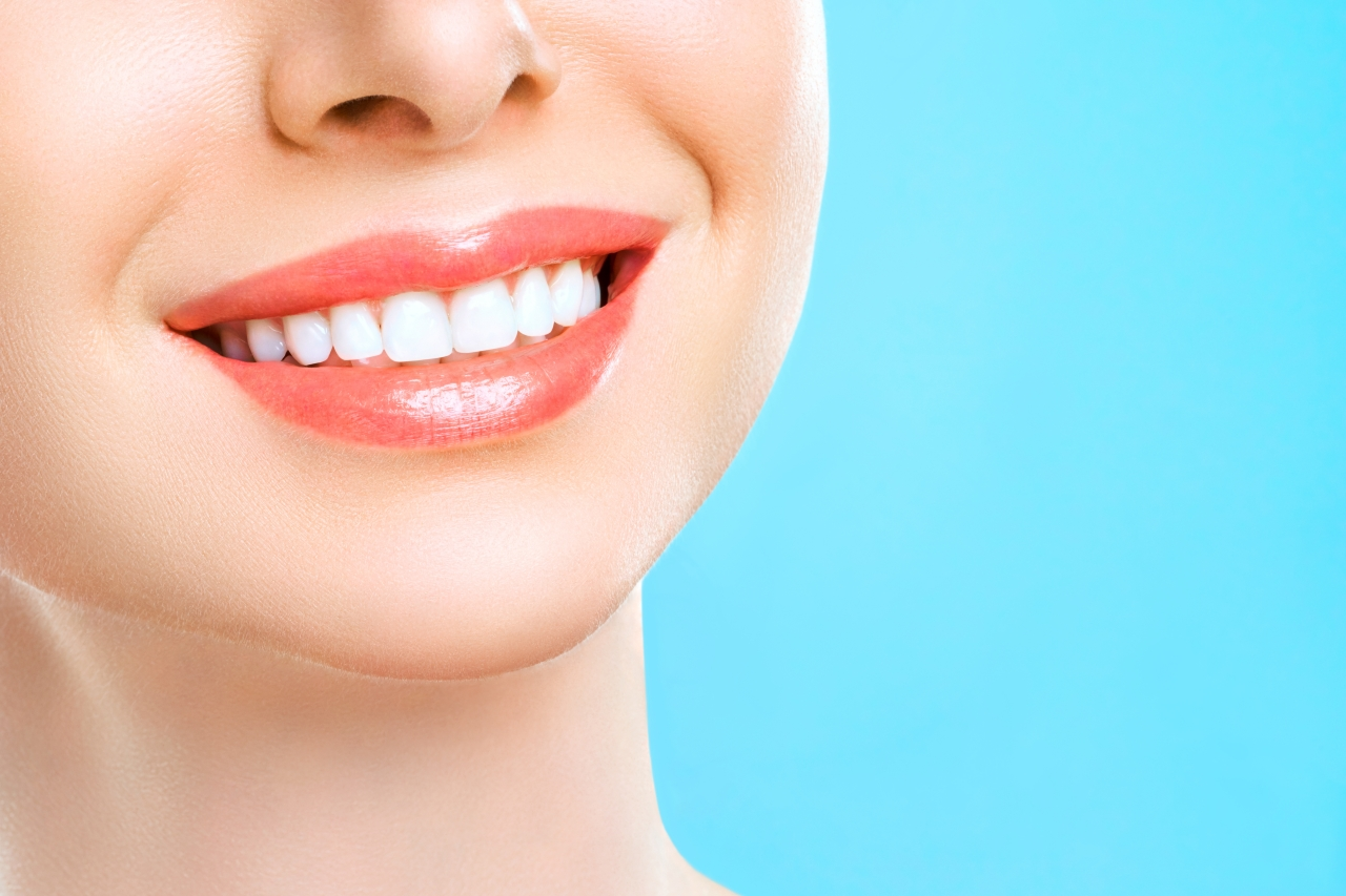 Woman with perfect teeth and gums